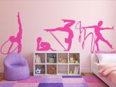 Rhythmic Gymnastic - Sports wall decals! Do you do rhythmic gymnastics, a sport that enchants and mesmerizes whoever watches a performance? Then personalize your bedroom with this set consisting of four silhouettes of gymnasts with different apparatuses.