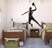 Basketball Player - Check our wall stickers on sports! If your favourite sport is basketball, decorate your bedroom with a silhouette decal of a basketball player about to perform a slam dunk.