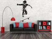 Skateboarder - Wall stickers on radical sports! Skateboarding might look scary and hard to many, but not to you! Give a taste of your favourite sport to your bedroom with a silhouette decal of a skateboarded performing an ollie.