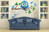 Wall decals for a baby room or kids room. Some owls like to be out during the day. That's the case of this round, little blue owl, who was feeling alone on its branch and was joined by singing birds.