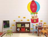 Kids love toys and bright colours! Take a look at this kit of wall decals inspired on felt dolls. Apply on a wall of the baby or kid room, amongst the yellow flower-shaped buttons, the colourful hot air balloon, which carries in its gondola a couple of kind teddy bears.