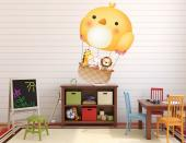 Fly with your children across the skies of your imagination with this wall decal for the decoration of the baby or kids room. Hop on the basket attached to a big hot air balloon shaped like a yellow bird and join a smiley giraffe, a curious bunny and a brave lion on an adventure up in the air!