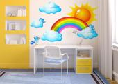 Wall stickers for the rooms of babies and kids. Surprise your children with this charming set of decals featuring a magnificent rainbow with its seven colours, an orange solar orb, small clouds and birds as blue as the sky after the rain.
