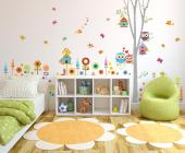 Wall decals for nurseries and kid rooms. A set of stickers specially designed for kids so they can help you apply them. We present you the Thousand-Colour Woods, where there aren't two creatures that look alike. The tree grows, the herbs and flowers sunbathe, the small birds chirp, the daily owls flirt, the butterflies flutter and the caterpillar greets everyone.